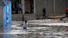 A girl walks in a flooded area after Hurricane Matthew in Les Cayes, Haiti, October 5, 2016. (ANDRES MARTINEZ CASARES/REUTERS)