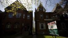 "A ""For Sale"" sign sits in front of a house, in Toronto, on April 20, 2010. (Darren Calabrese/THE CANADIAN PRESS)"