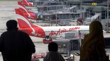 Dozens of low-cost competitors have followed AirAsia CEO Tony Fernandes in cashing in on the burgeoning middle class. (TEH ENG KOON;/AP)