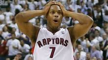 Toronto Raptors guard Kyle Lowry reacts after a long shot against the Brooklyn Nets in Game 5 of the first round of the 2014 NBA Playoffs at the Air Canada Centre. (USA TODAY Sports)