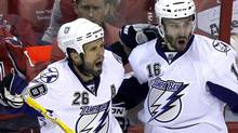 Tampa Bay Lightning's Martin St. Louis. left, and Teddy Purcell celebrate St. Louis' goal during the third period in Game 2 of a conference semifinal NHL Stanley Cup hockey playoff series with the Washington Capitals Sunday, May 1, 2011 in Washington. (AP Photo/Alex Brandon) (Alex Brandon/AP)