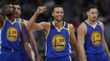 The signing of Kevin Durant to Golden State created a four-man dynamic that had never previously existed in the NBA – Steph Curry (center) is John; Durant (L) is Paul; Klay Thompson (R) is George; and below-the-belt puncher Draymond Green (not pictured) is Ringo, writes Cathal Kelly. (David Zalubowski/AP)