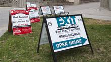Real estate signs sit outside of the Marina Del Rey condos on Lake Shore Blvd. West in Toronto on Sunday, April 28. 2013.  (Matthew Sherwood For The Globe and Mail)