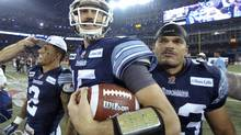 Argonauts #11 Dontrelle Inman and Argonauts #15 Ricky Ray after winning the 100th Grey Cup game played in Toronto on Nov. 25, 2012 between the Toronto Argonauts and the Calgary Stampeders. (Peter Power/The Globe and Mail)
