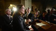 Jane Philpott, Federal Minister of Health and Ralph Goodale, Minister of Public Safety and Emergency Preparedness, make an announcement regarding an act to amend the Controlled Drugs and Substances Act and to make related amendments to other Acts during a press conference in the foyer of the House of Commons on Parliament Hill in Ottawa on Monday, Dec. 12, 2016. (Sean Kilpatrick/THE CANADIAN PRESS)