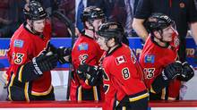 Calgary Flames centre Joe Colborne celebrates his goal with teammates against the San Jose Sharks during the second period at Scotiabank Saddledome. (USA TODAY Sports)
