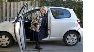 Mary Lou Fallis and her Toyota Echo.