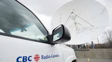 A CBC/Radio-Canada van is shown next a satellite dish at the CBC/Radio Canada building in Montreal on April 4, 2012 (CP)