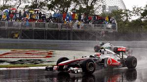 McLaren Mercedes driver Jenson Button, of Britain races to victory at the Canadian Grand Prix, Sunday, June 12, 2011 in Montreal.