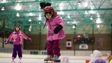 Two girls take skating lessons at Sunset Rink in Vancouver in February, 2012. A motion that passed by a vote of 3-2 at a Vancouver park board meeting Monday night has advised city staff to come up with a code of conduct outlining appropriate behaviour for parents at minor sporting events. (Ben Nelms for The Globe and Mail)