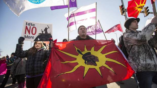 Idle No More protesters march towards the Ambassador Bridge in Windsor, Ont.