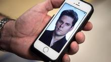 La Presse columnist Patrick Lagacé is seen on a mobile phone screen in this illustration. (Paul Chiasson/THE CANADIAN PRESS)