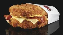 The KFC Double Down is essentially a sandwich with two chicken filets taking the place of bread slices. In between are two pieces of bacon, melted slices of Monterey Jack and Pepper Jack cheese and a zesty sauce. (Associated Press/Associated Press)