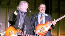 The National Music Centre's Andrew Mosker, right, and musician Randy Bachman are takin' care of the business of culture in Calgary at the Studio Bell naming announcement. (National Music Centre)