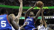 FILE - In this April 5, 2014, file photo, Philadelphia 76ers' Thaddeus Young goes to the basket against the Brooklyn Nets during an NBA basketball game in Philadelphia. (Michael Perez/AP)