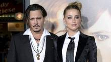 """Amber Heard and husband Johnny Depp pose during the premiere of the film """"The Danish Girl,"""" in Los Angeles, California November 21, 2015. (KEVORK DJANSEZIAN/REUTERS)"""