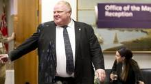 Mayor Rob Ford exits his office at City Hall in Toronto on May 31, 2013. Mayor Ford said at the elevator that he has just hired two new people. (Peter Power/The Globe and Mail)