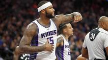 Sacramento Kings center DeMarcus Cousins looks for an explanation from an official after fouling a Toronto Raptor player during the first half of an NBA basketball game in Sacramento, Calif., Sunday, Nov. 20, 2016. (STEVE YEATER/ASSOCIATED PRESS)