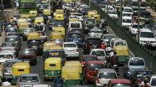 Vehicles travel along a busy road in New Delhi June 9, 2010. (MUKESH GUPTA/REUTERS/MUKESH GUPTA/REUTERS)