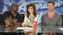 "In this 2008 image released by FOX, ""American Idol"" judges, from left, Randy Jackson, Paula Abdul and Simon Cowell are shown on the set in Los Angeles. Audience declines for ""American Idol"" are most steep among youthful viewers, the people who set the pop culture agenda and are most likely to buy music made by the show's winners. (Michael Becker/AP)"