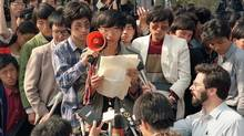 This file photo taken on May 1, 1989 shows Wang Dan (centre), a leading Chinese dissident during 1989 Tiananmen Square pro-democracy demonstrations addressing foreign correspondents in Beijing. (CATHERINE HENRIETTE/AFP/Getty Images)