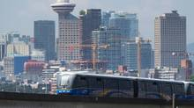 A Skytrain travels in Vancouver in May, 2015. The more irregular buildings in the city's skylines are the most at risk in the event of an earthquake. (DARRYL DYCK For The Globe and Mail)