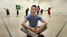 Matthew MacDonald poses for photos while sports are played behind him at Pierre Trudeau School in Toronto, November 5, 2014. (J.P. MOCZULSKI For the Globe and Mail)