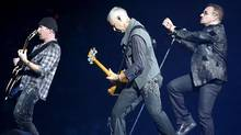 Lead singer Bono (R) of the rock band U2 performs with guitarist The Edge (L) and bass guitarist Adam Clayton (C) during the first of two concerts at Giants Stadium in East Rutherford, New Jersey in 2009. (GARY HERSHORN/GARY HERSHORN/REUTERS)