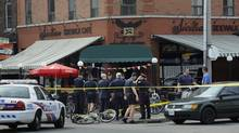 Mr. Raposo's was shot on the crowded patio of the Sicilian Sidewalk Café at College Street and Montrose Avenue in LIttle Italy. (Fred Lum/The Globe and Mail)