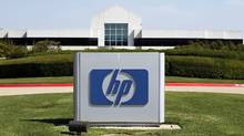 The Hewlett-Packard Co. logo is displayed outside the company's HP Enterprise Services unit in Plano, Tex., in 2012. (Mike Fuentes/Bloomberg)