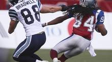 Toronto Argonauts Mike Bradwell (88) tackles Montreal Alouettes' Trent Guy by the hair during first half CFL football action in Montreal September 23, 2012. (CHRISTINNE MUSCHI/REUTERS)