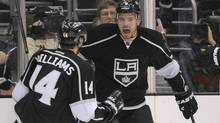 Los Angeles Kings defenseman Drew Doughty, center, celebrates with right wing Justin Williams after scoring the game-winning goal during the third period of their NHL hockey game against the Columbus Blue Jackets, Wednesday. (Mark J. Terrill/Associated Press)