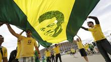 Brazil fans carry a picture of soccer legend Pele before the 2014 World Cup Group A soccer match between Cameroon and Brazil at the Brasilia national stadium in Brasilia on June 23. (UESLEI MARCELINO/REUTERS)
