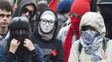 Masked protesters take part in an anti-capitalist demonstration in Montreal, Tuesday, May 1, 2012. (Graham Hughes/THE CANADIAN PRESS/Graham Hughes/THE CANADIAN PRESS)