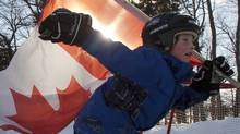 Jacob Sanderson, 9, celebrates Hockey Day in Canada on a pond rink near Bobcaygeon Ontario on Pigeon Lake, Saturday February 12, 2011. The annual event celebrates the roots and spirit of Canadian hockey across Canada. THE CANADIAN PRESS/Fred Thornhill (Fred Thornhill)