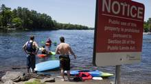 Vacationers prepare to kayak around the north Bala Falls in Muskoka in June. (Matthew Sherwood For The Globe and Mail)