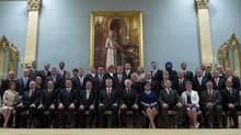 Canadian Prime Minister Stephen Harper, front centre, poses for a group photo with the Cabinet announced during a ceremony at Rideau Hall in Ottawa on Monday, July 15, 2013. (Adrian Wyld/THE CANADIAN PRESS)