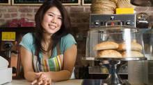 Smiling woman in coffee shop (Jupiterimages/www.jupiterimages.com)