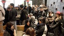 Dozens of patrons line up outside Guu, a new restaurant in Toronto that does not take reservations. (J.P. MOCZULSKI/J.P. Moczulski for The Globe and Mail)