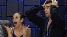 Meagan Duhamel and Eric Radford react as their score is posted after their skate to gold in the senior pair free competition at the Canadian figure skating championships in Moncton, N.B. on Saturday, Jan. 21, 2012. (Andrew Vaughan/THE CANADIAN PRESS)