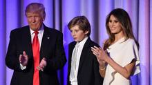 U.S. president-elect Donald Trump is pictured with his son Barron and wife Melania at the New York Hilton Midtown on Nov. 8, 2016. (SAUL LOEB/AFP/Getty Images)