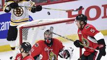 Ottawa Senators goalie Craig Anderson keeps his eye on the puck as defenceman Cody Ceci, right, looks on during Game 1 of the NHL Stanley Cup hockey playoff action against the Boston Bruins, in Ottawa on Wednesday, April 12, 2017. (Sean Kilpatrick/THE CANADIAN PRESS)