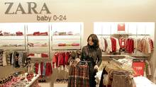 A customer looks at outfits at a Zara shop in Shanghai. (ALY SONG/REUTERS)