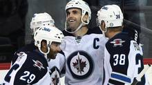 Andrew Ladd, centre, of the Winnipeg Jets is congratulated by teammates Johnny Oduya, left, and Paul Postma after his second period goal against the Nashville Predators in preseason NHL action at the MTS Centre. (Marianne Helm/2011 Getty Images)