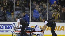 Tampa Bay Lightning centre Steven Stamkos (91) is wheeled off on a stretcher during the second period against the Boston Bruins at TD Banknorth Garden. (Bob DeChiara/USA Today Sports)