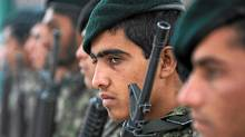 Afghan National Army soldiers attend a ceremony to hand over security control in the city of Charikar in Parwan province on Dec. 1, 2011. (Shah Marai/AFP/Getty Images/Shah Marai/AFP/Getty Images)