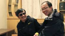 Blind legal activist Chen Guangcheng (L) and Hu Jia, one of China's most prominent dissidents, smile during a meeting, after Chen fled from house arrest, in Beijing, in this picture taken late April 2012 and released to Reuters April 28, 2012. (Reuters/Reuters)