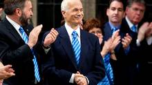 New Democratic Party leader Jack Layton is applauded as he is joined by the members of Parliament wearing blue ties and scarves in honour of his fight against prostate cancer during question period in the House of Commons on Parliament Hill in Ottawa. (Sean Kilpatrick/THE CANADIAN PRESS)