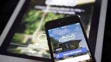 The Airbnb application is displayed on an iPhone and iPad in this arranged photo. (Andrew Harrer/Bloomberg)