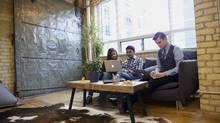 Sensibill employees Preetinder Kaur, Arindam Bhadra and Jan-Lukas Wolf at the company's Toronto office (Sensibill)